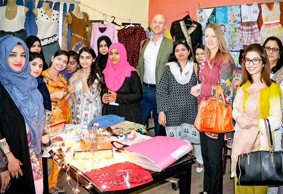 Students of the Pakistan Ready-Made Garments Technical Training Institute in Karachi showcase their wares for the delegates. Photo: UN Women/Habib Asgher