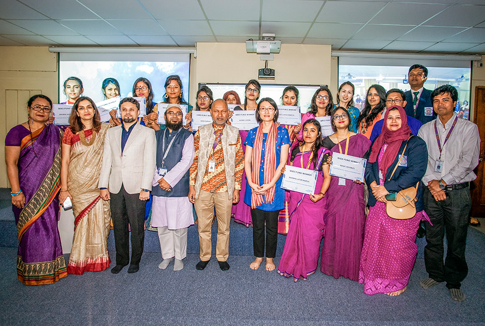 Female students from BRUR proudly display their seed funding awards at the Women Peace Café launch event in Rangpur. Photo: UN Women/Fahad Kaizer