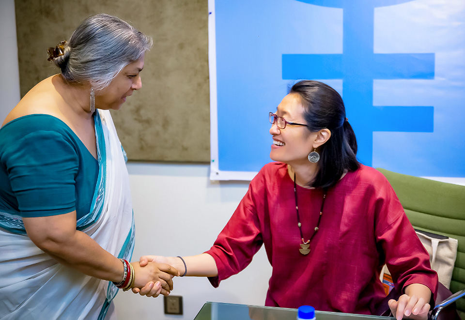Shoko Ishikawa of UN Women greets Shireen Huq from Naripokkho, a Bangladesh women's activist organization, at the 20 June workshop. Photo: UN Women/Sohag Ahmed