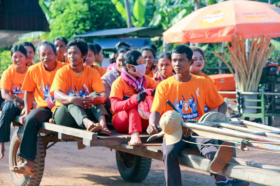 Men on an oxcart join a Government-organized march in Siem Reap, northwestern Cambodia, on 6 December 2018. It was part of the United Nations 16 Days of Activism against Gender-based Violence, for which orange is the theme colour. Photo: UN Women/Vutha Phon