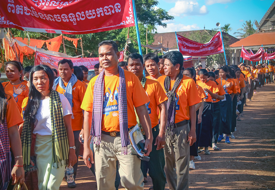 """About 300 people including many men march to raise awareness about violence against women, in Siem Reap province of northwestern Cambodia, on 6 December 2018. """"Orange the World"""" was the theme of the global activism campaign for women's safety and dignity. Photo: UN Women/Vutha Phon"""