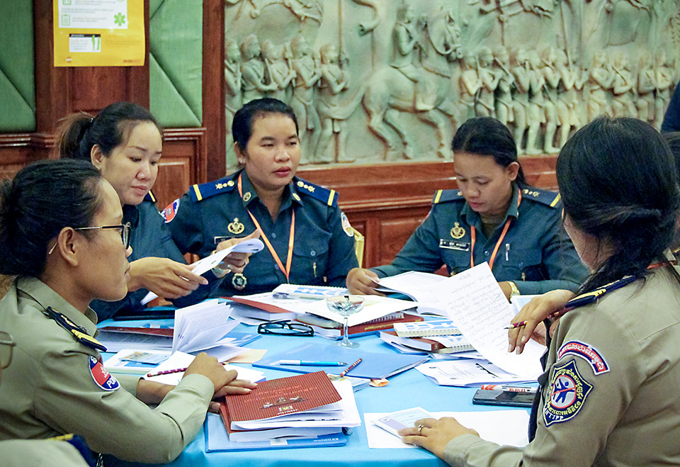 Police officers and gendarmeries participate in a UN Women-organized workshop on identifying and interviewing survivors of gender-based violence and human trafficking. The training was held in 12 provinces of Cambodia in April 2019. Photo: UN Women/Vutha Phon