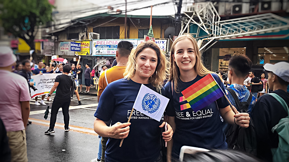 (from left) Rebecca Singleton of UN Women and Kate O'Shannessy of International Organization for Migration show their support at the Metro Manila Pride march on 29 June. Photo: Alecs Ongcal