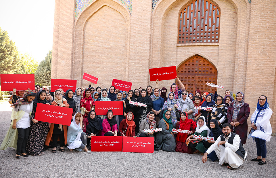 Women's rights defenders gather in front of Gawharshad Begum's tomb in Herat to start the new #MyRedLine campaign to amplify the voices of women in peacebuilding. Photo: UN Women/Sushant Kumar