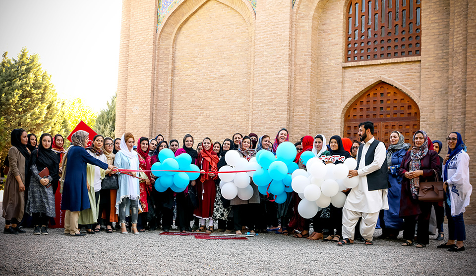 Participants at the #MyRedLine2 launch in front of Gawharshad Begum's tomb in Herat release balloons tagged with red ribbons, to tell the world about their red lines on women's rights. Photo: UN Women/Sushant Kumar