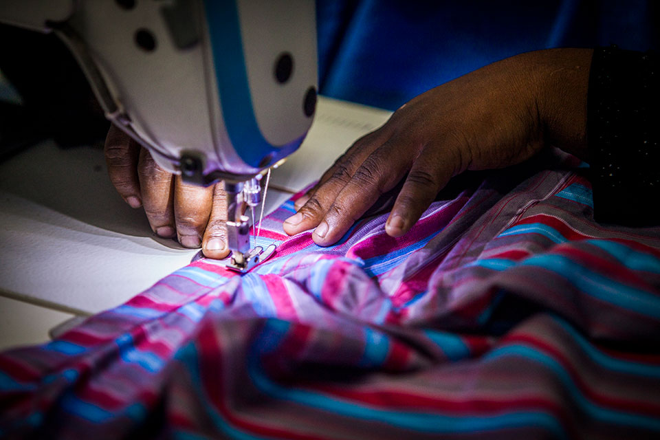 Hands of a worker plying her trade at Glamour Boutique House and Training Center. Photo: UN Women/Fahad Kaizer