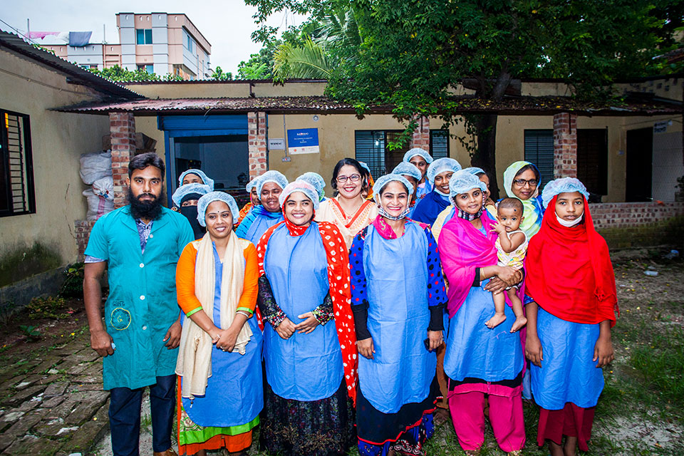 Parveen Akter (center) with workers. Photo: UN Women/Fahad Kaizer