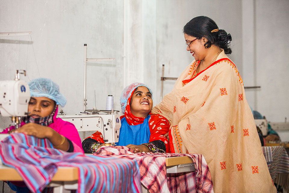 Parveen Akter, owner of Glamour Boutique and Training Center, with budding workers at her training center at Ghop Nawapara Road in Jessore. Photo: UN Women/Fahad Kaizer