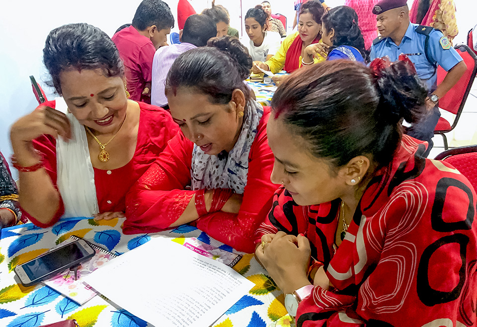 Two generations of women brainstorm on how to address serious concerns by analyzing the case studies of gender-based violence and find solutions. Photo: UN Women