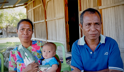 """Norberto Oliveira da Silva, a farmer shown here with his wife and granddaughter, has attended trainings provided by Amaral do Carmo. He says: """"Through this training I learned that men and women can help each other. Men can go to the market. Men can work in the house."""" Photo: UN Women/Emily Hungerford"""