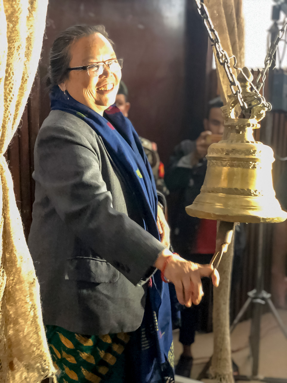 Tham Maya Thapa, former Minister of Women, Children and Senior Citizen, ringing the Nepali bell to launch the national consultation for Beijing+25 review organized by National Network of Beijing Review Nepal (NNBN) with UN Women's support. Photo: UN Women/Naresh Newar