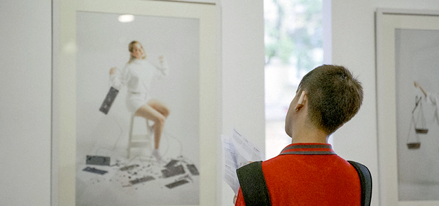 A visitor looks at photographs in the exhibition. Photo: Courtesy of IKIGAI