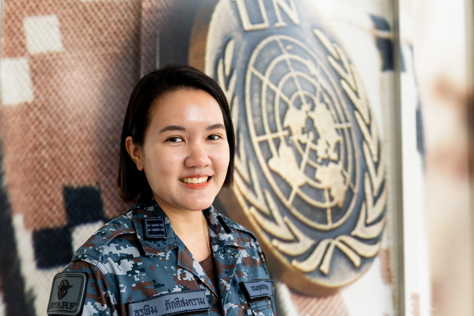 Squadron leader Orapim Pakdeesongram, shown here at the Peace Operations Center in Bangkok, is passionate about teaching colleagues about international peacekeeping. Photo: UN Women/Pairach Homtong