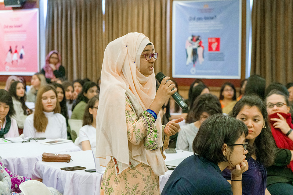 A student of the university asks the panellists a question. Photo: Lauren Kana Chan/Asian University for Women