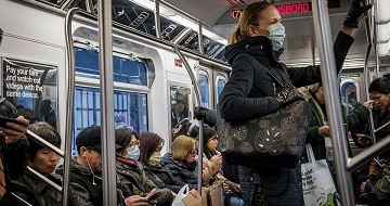 A woman on public transit in New York wears face mask in March 2020; Photo: UN Photo/Loey Felipe