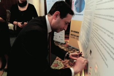 Giorgi Khatsakvadze, Head of Marketing and Quality Management B.I.G Microfinance Organization signing the WEPs