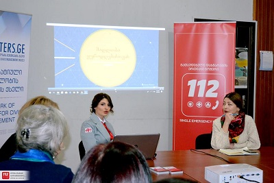 Representatives of UN Women and 112 presenting the 112 app's new functionality to local civil and community organizations and local government representatives in Zugdidi