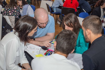 Students work in groups of three to five to develop their proposals for the universities and companies