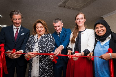 Cutting the ribbon to open the Qusar Women's Resource Centre, (from left to right) Mr. Alessandro Fracassetti, Prof. Hijran Huseynova, Mr. Elman Mustafayev, Dr. Simone Haeberli, Ms. Mehjabeen Alarakhia