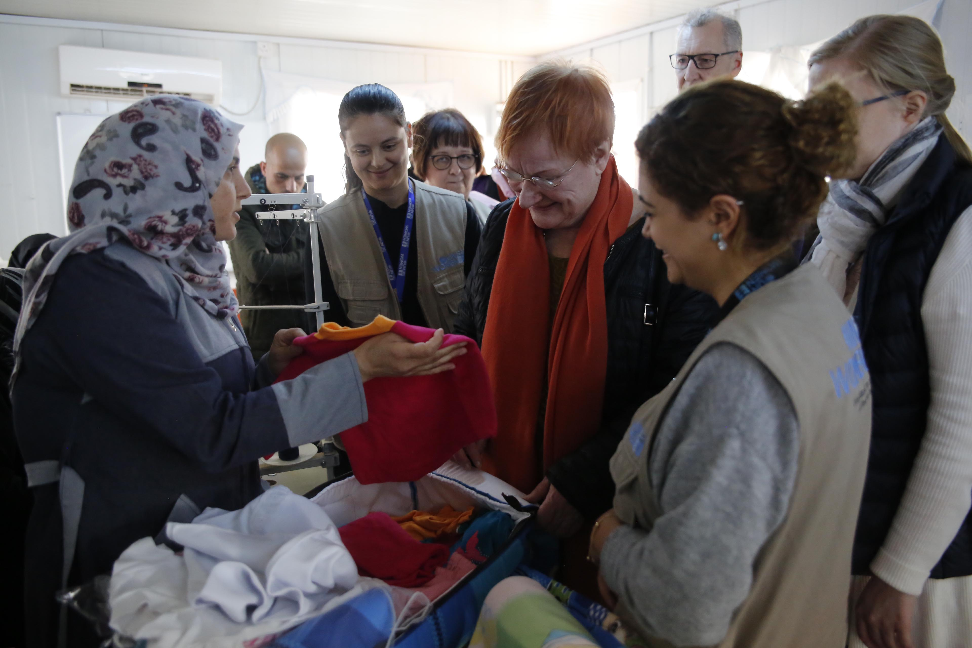 Tarja Halonen visits the Tailors who make Baby Kits for in camp mothers.