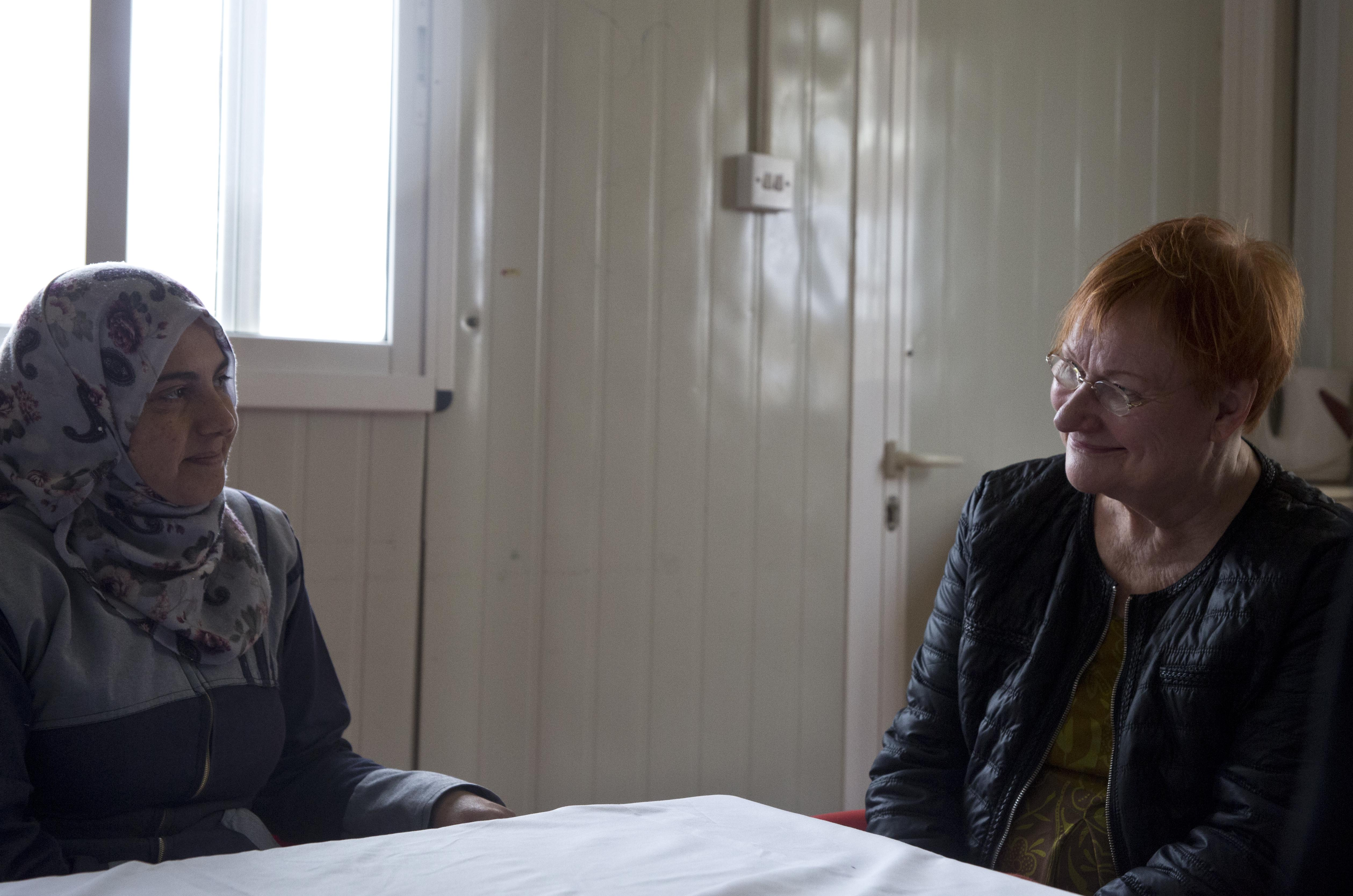 Tarja Halonen speaks to the women that work within the Oasis after her tour.