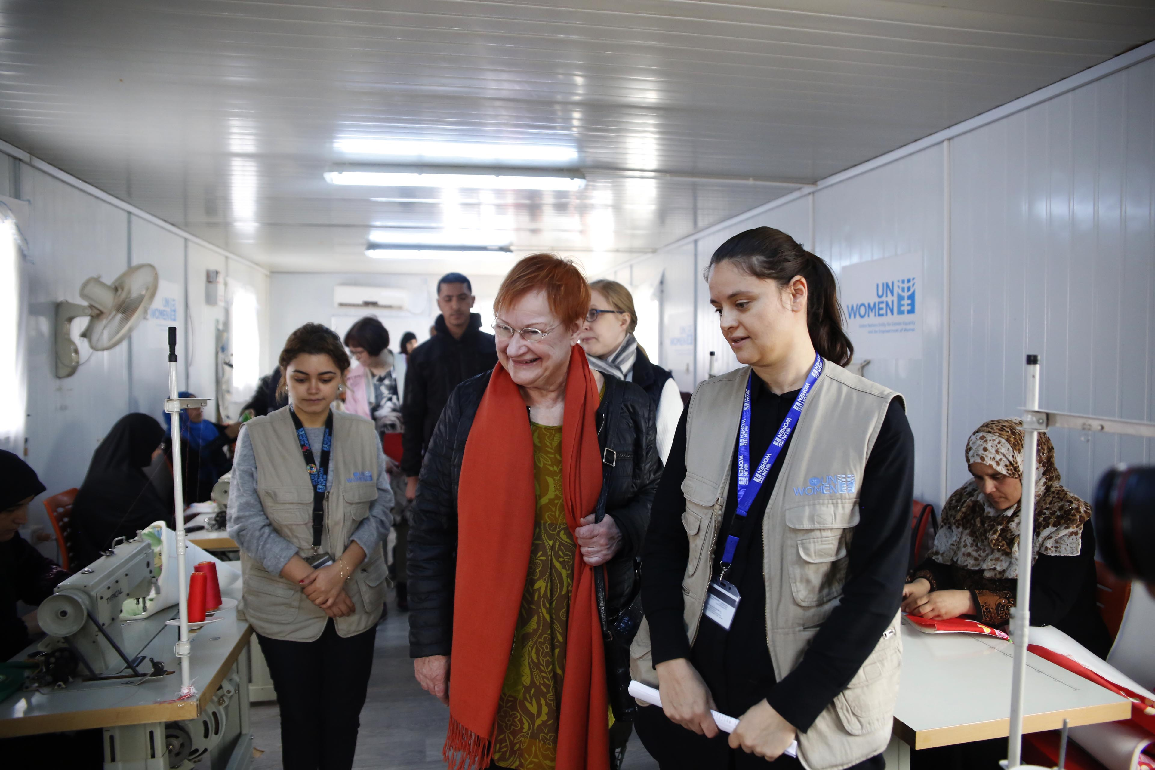 Tarja Halonen visits the women within the tailoring centre.
