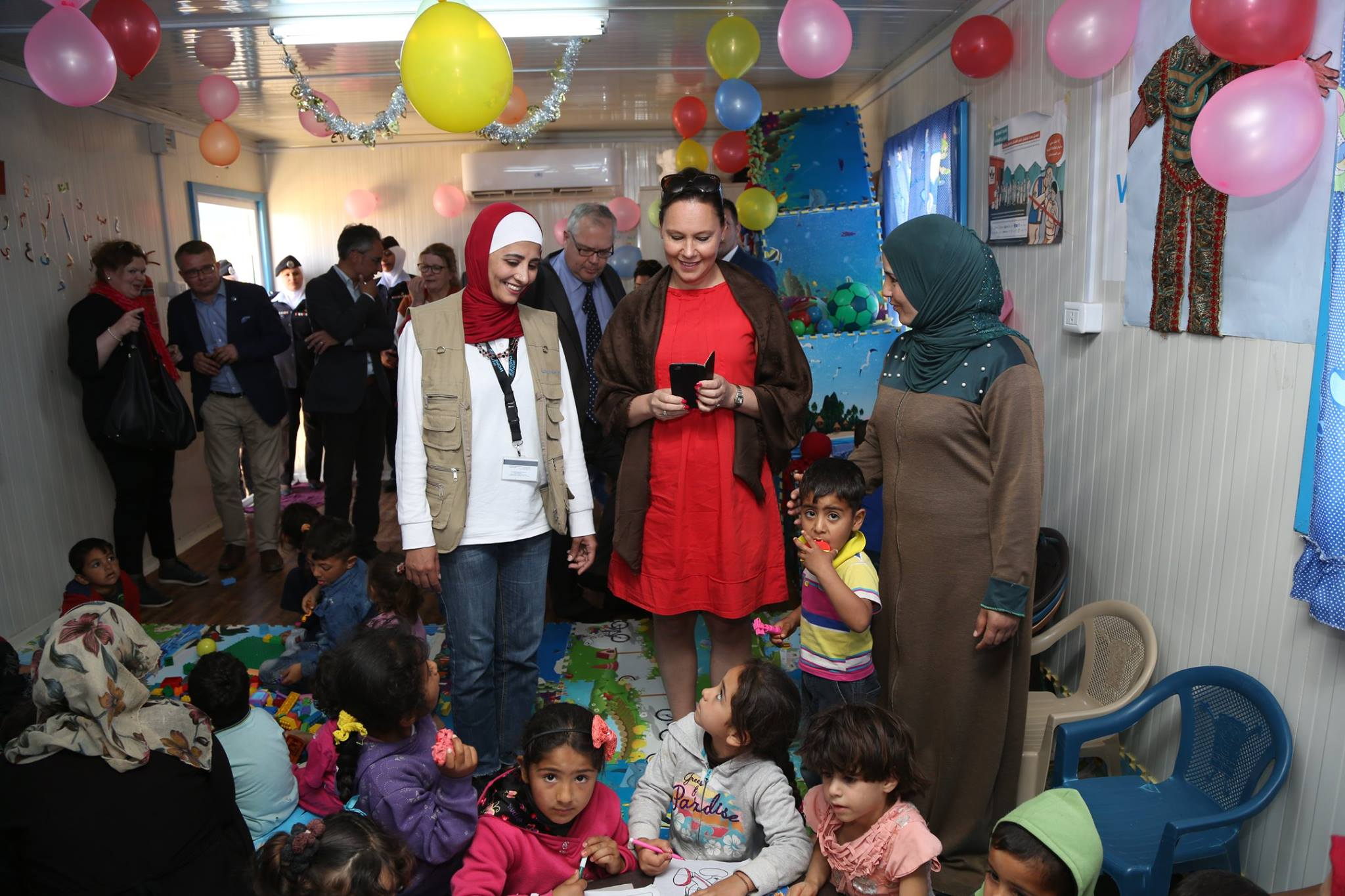 Mrs. Virolainen had the chance to greet women within each of the sectors available to the women and girls livelihood centre including the childcare and nursery facilities. Photo source: UN Women/ Ghaith Al Bahri