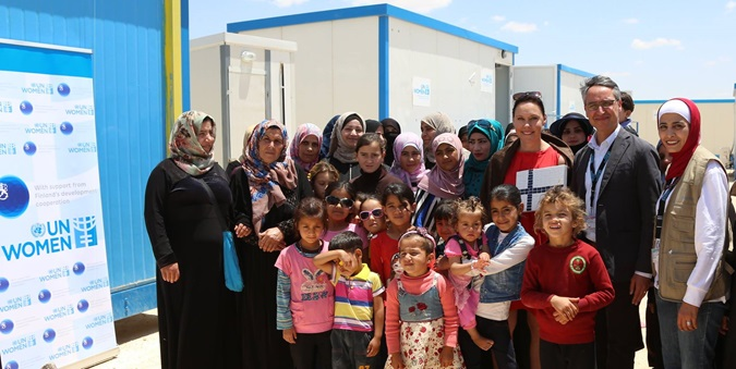 Finland Minister for Foreign trade and Development, Anne-Mari Virolainen received a handcrafted mosaic from the women within the UN Women Oasis and joined the UN Women Country Representative Ziad Shiekh, women and children of the Oasis for a group photo. Photo source: UN Women/ Ghaith Al Bahri