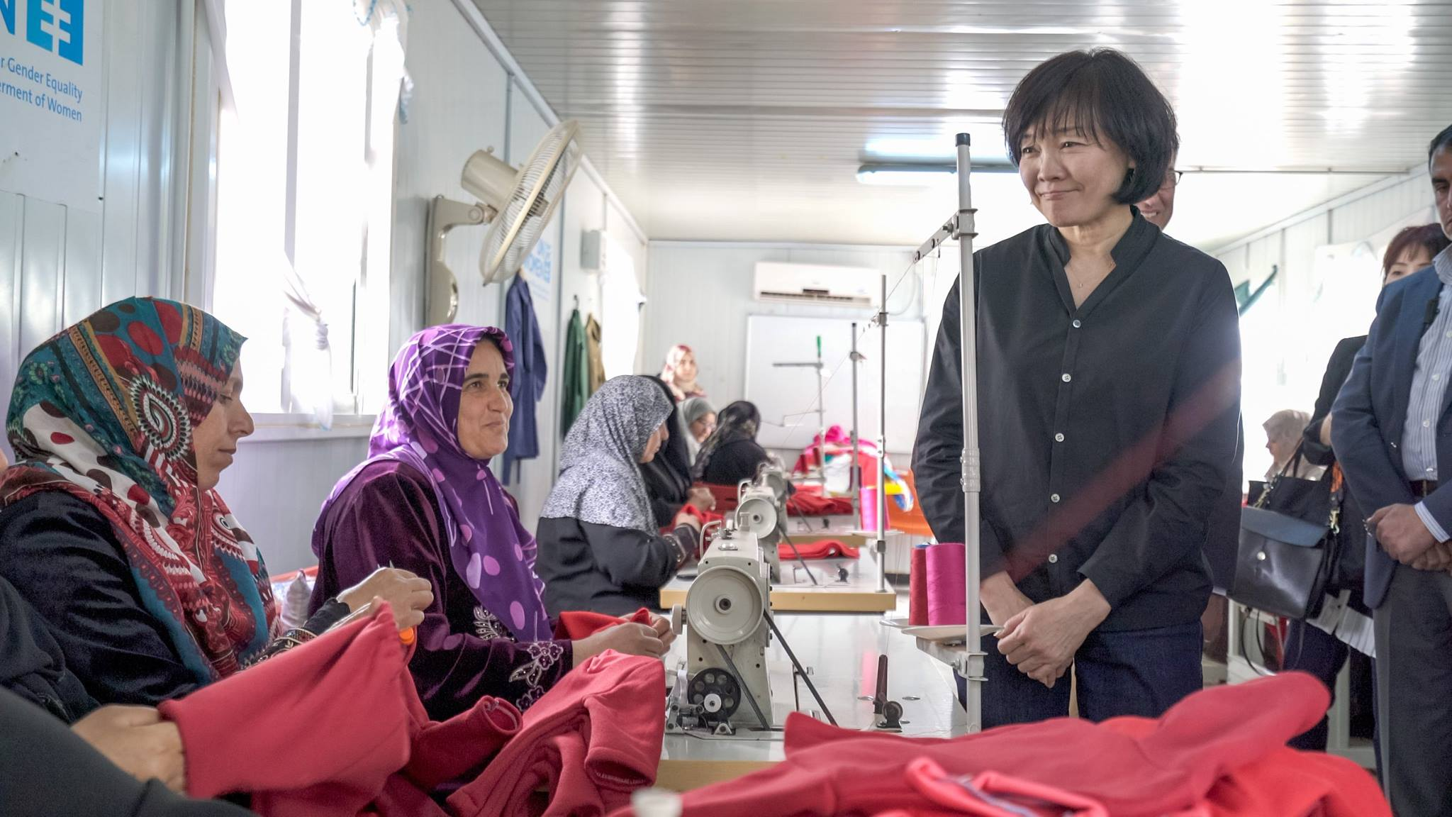 The First Lady, Mrs. Akie Abe visits the tailoring center within the Oasis, meeting the women crafting the baby kits that are distributed throughout the camp hospitals each month. Photo source UN Women/Christopher Herwig