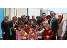Finland Minister for Foreign Trade and Development greets Syrian women and children in Azraq UN Women Oasis