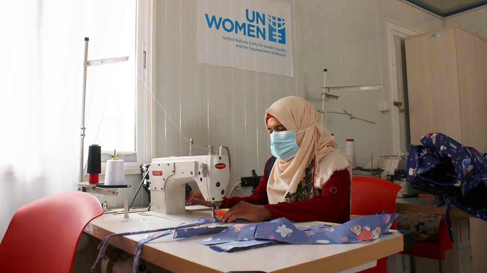 Fatma Mohammad Rahil, 33, leads the sewing team at the UN Women Oasis center in the Azraq refugee camp. Photo: UN Women/Yeji Lee