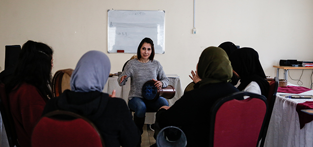 Musician and social worker Lara Elayyan, 35, leads a session on rhythm as part of the musical therapy sessions at the Jordanian Women's Union. Photo: UN Women/ Lauren Rooney