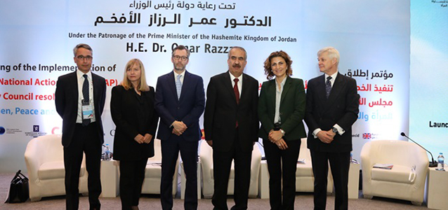 Mr. Ziad Sheikh, UN Women Jordan Representative; Ms. Paivi Kannisto, Chief, Peace and Security Section and Director of Policy, a.i., UN Women; H.E. Ambassador Peter MacDougall, Ambassador of Canada to Jordan; H.E. Samir Ibrahim Mohammad Mbaidin, Minister of Interior of the Hashemite Kingdom of Jordan; Dr. Salma Nims, Jordanian National Commission for Women Secretary General and H.E. Ambassador Edward Oakden, Ambassador of United Kingdom to Jordan, convene for a group photo at the launching of the implementation of the Jordanian National Action Plan.