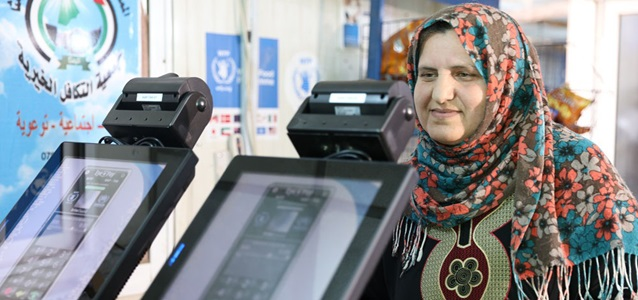 A woman utilizes the benefits of WFP's cash assistance via blockchain in Jordan. Photo: WFP/ Mohammed Batah.