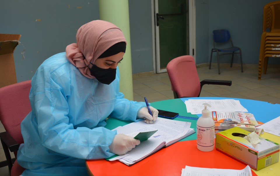 Leila Saleh* receives training at a COVID-19 vaccination centre in Nablus, the West Bank. Photo: Juzoor