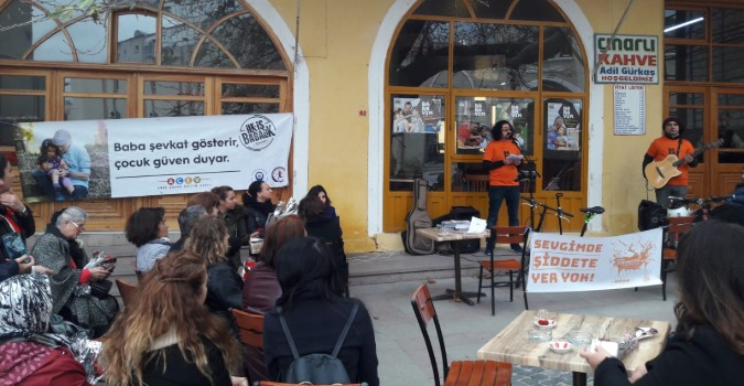 Graduates of the Father Support Programme perform songs about women's empowerment during the 16 Days of Activism. Photo: Mehmet Osman Cetiner/ACEV