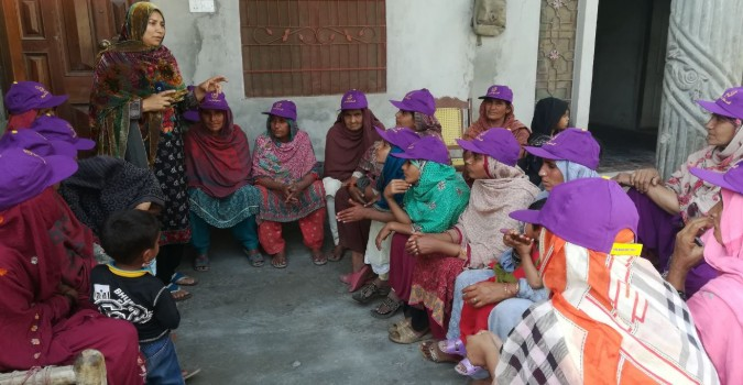 Farah Batool, a member of a community action group in Pakistan speaks about gender-based violence to women in Punjab, Pakistan. Photo: Shirkat Gah - Women's Resource Centre