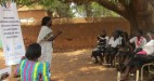 Christin, a SIHA Project Officer, discusses the project plan with students in Wau. Photo: SIHA