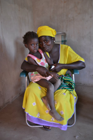 Ndyandin Dawara, trained by GAMCOTRAP, who is a survivor of FGM, shares that she will not subjugate her daughter to FGM. A decision that is supported by her husband who is a community facilitator for GAMCOTRAP. Photo: UN Trust Fund Monitoring and Evaluation Specialist/Gemma Wood