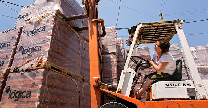 Amira Abi Khalil operates a forklift to move palettes of tile. She has owned and operated her brick and stone trading company in Lebanon since 1997. UN Women procures goods and services from women-owned firms such as hers. Photo: UN Women/Joe Saade.