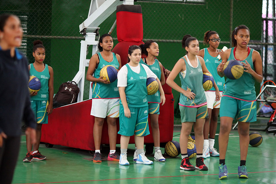 Led by Coach Ellen Rosa, the girls go through physical conditioning, basketball fundamentals, tactics and techniques, and prepare for competition. They work hard to improve their skills and excel on the court.