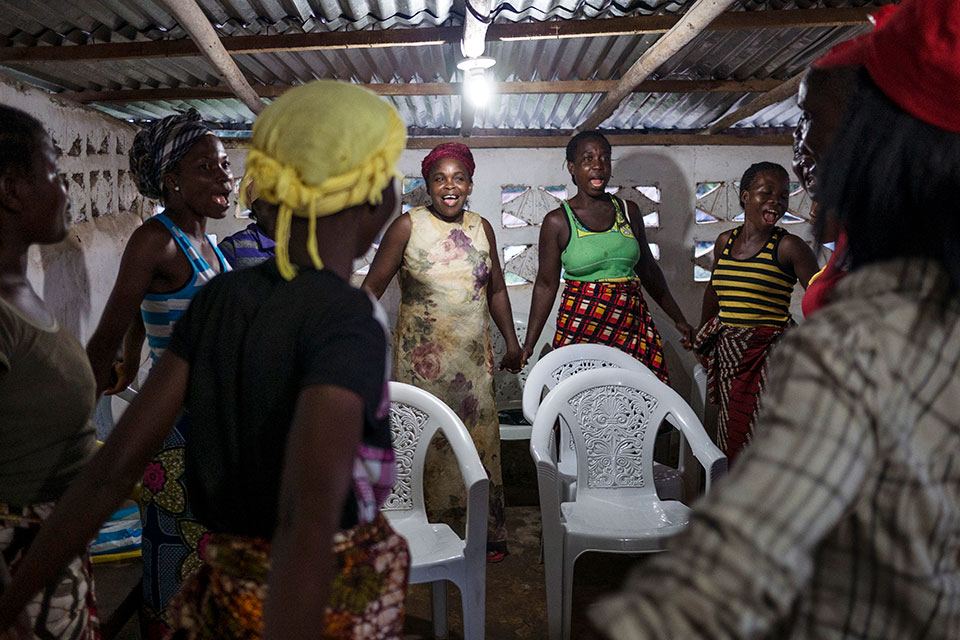 Jubilant women of Juah Town sing during one of their regular adult literacy training sessions held at the Peace Hut. Photo: Thomas Dworzak/Magnum Photos for UN Women