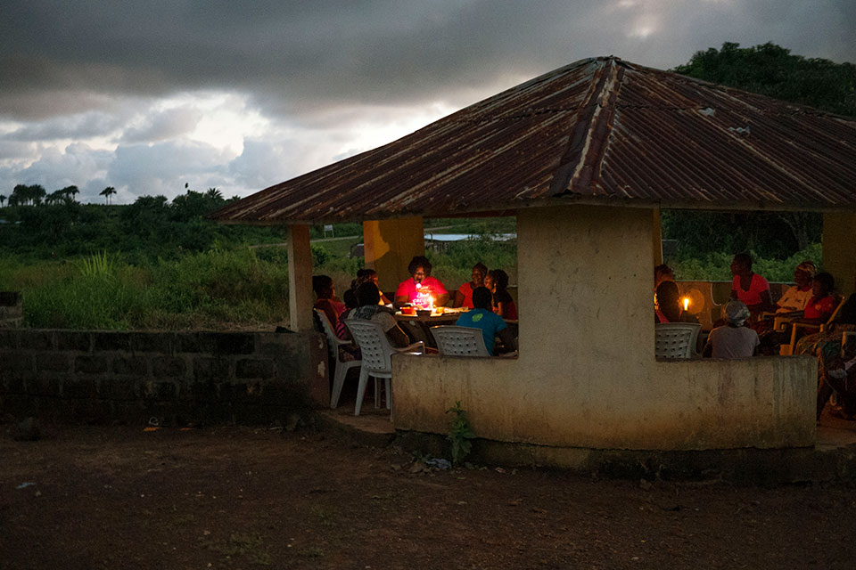 "Women gather in a ""Peace Hut"" in Margibi County. Photo: Thomas Dworzak/Magnum Photos for UN Women"