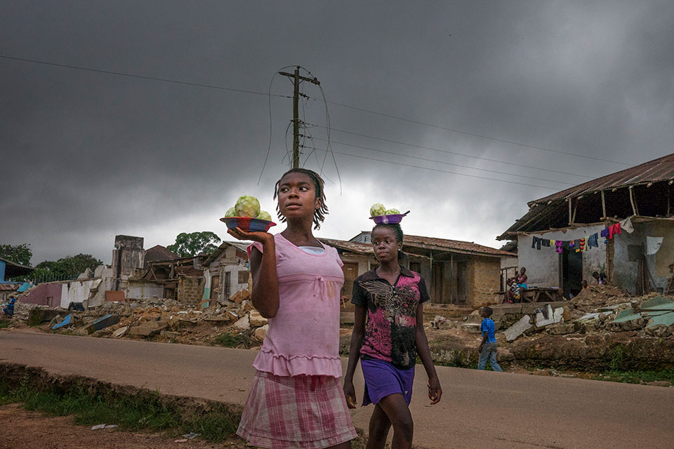Photo essay: Rural women light up villages in Liberia