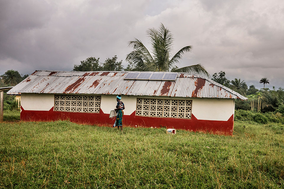 Built with support from UN Women, this Peace Hut in the village of Todee also serves as a workshop space and warehouse for the women solar engineers. Photo: Thomas Dworzak/Magnum Photos for UN Women