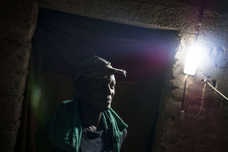 57-year-old Anthony Sorbor of Todee Community has electricity for the first time and no longer worries about finding money to buy candles or kerosene. Photo: Thomas Dworzak/Magnum Photos for UN Women