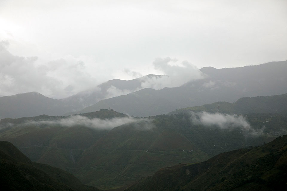 Views of misty mountains from the municipality of El Tablón de Gómez, in the southeast of Nariño territory, Colombia. The municipality is known for its coffee and scarred by decades of conflict between the Colombian guerillas.