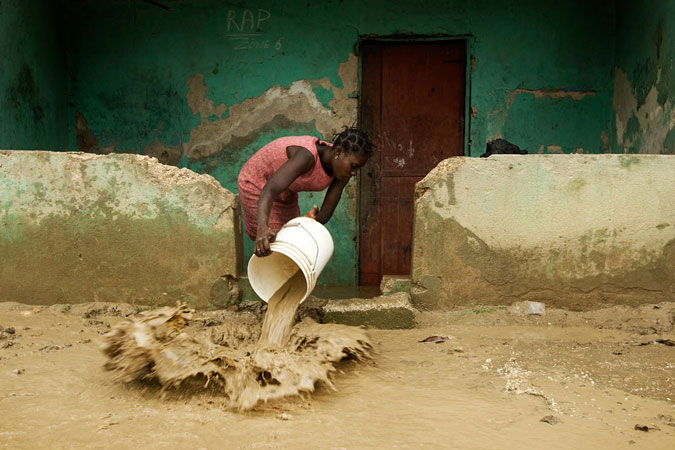 A woman cleans up her home in Cite Soleil. Hurricane Gustav passed through Haiti yesterday dumping heavy rains that flooded thousands of homes and left approximately 50 people dead. Photo: UN Photo/Marco Dormino