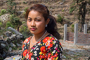 Sita Shrestha stands infront of community tab at Irkhu VDC-7 in Sindhupalchwok, Nepal. Photo: UN Women/N. Shrestha