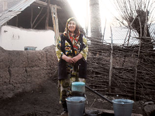 "Surayo Mirzoyeva, 41, took part in a self-help group supported by the UN Women project ""Empowering abandoned wives of migrant workers in Tajikistan,"" which has provided more than 3,000 villagers in Fathobod, Tajikistan, with clean drinking water. Photo: UN Women/Humairo Bakhtiyar"